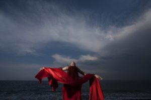 woman wearing red cape